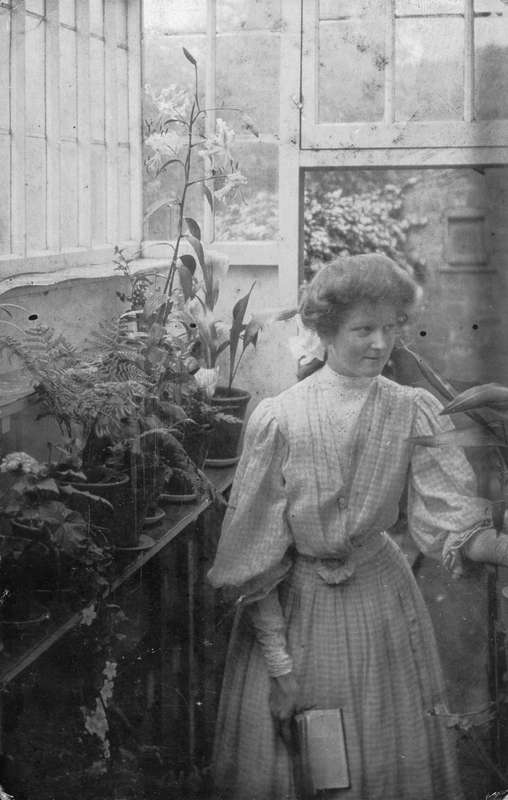 Ethel Bryant (later Wilson) in a greenhouse